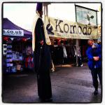 A man dressed as a bishop on stilts at Greenbelt 2012!