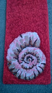 This ammonite was created by batik and embroidery.