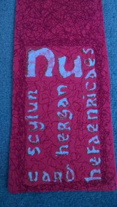 This is the first line of Caedmon's hymn of praise to the creator in Old English (preserved for us by the Venerable Bede). This was created in batik and embroidered.