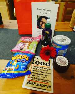 Picture of the contents of a goodie bag given to people at the funeral including port and cheese!